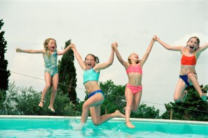 Girls playing at the pool